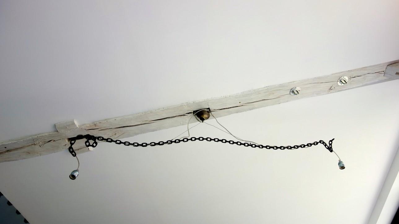 Suspension des kunstlers. Design by Franz West (1947-2012). Iron chain, bronzed, welded
