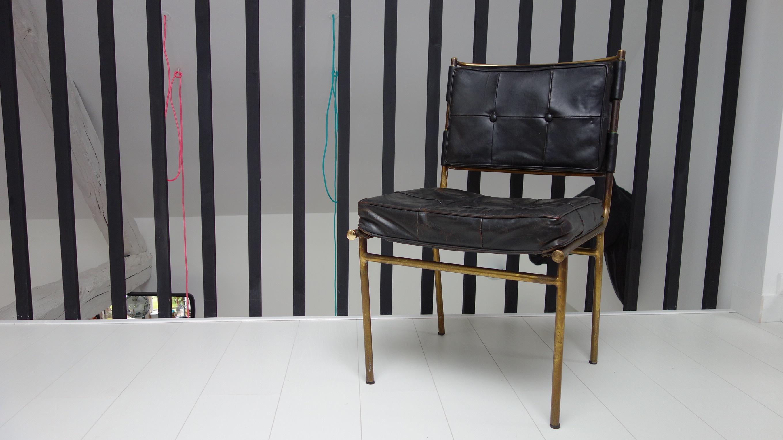 Mathieu Matégot, chaise capitonnée cuir noir et laiton, 1960