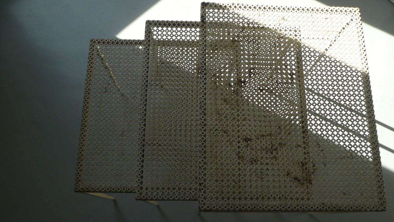 nest of table, perforated metal by mathieu mategot, 1952. Tables gigogne, métal perforé motif trèfle. Mathieu Matégot; 1952.